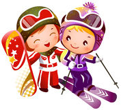 Boy and Girl skiing. There are one boy and one girl skiing. They have on ski jackets and ski boots Royalty Free Stock Images