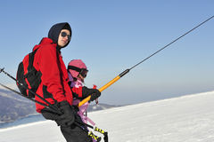 Boy and girl on the skilift Stock Image