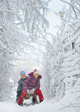 Boy And Girl at sledging Through Snowy Stock Photography