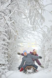 Boy and girl at sledging Royalty Free Stock Images