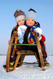 boy and girl on a sleigh Royalty Free Stock Image