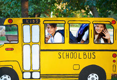 Boy and girl in small school bus Stock Image