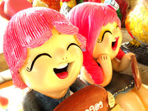 Boy and girl smile doll figure Stock Photo