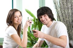 Boy and girl with smile with wineglasses Royalty Free Stock Images