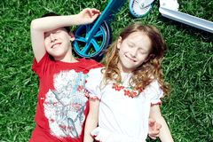 Boy and girl smiling lie on the grass Royalty Free Stock Photos