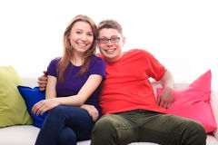Boy and girl on the sofa Royalty Free Stock Photos