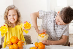 Boy and girl squeezed orange juice Stock Photo
