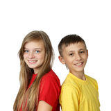 Boy and girl stand back to back Stock Photo