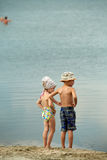 Boy and girl stand. Look at the sea Royalty Free Stock Photography