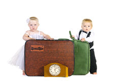 A boy and a girl stand near luggage Stock Image