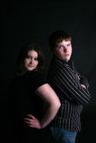 Boy and girl standing back to with attitude Royalty Free Stock Image