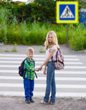 Boy and a girl standing near a pedestrian crossing Stock Image