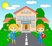 Boy and girl standing near the school building in a schoolyard Royalty Free Stock Photo