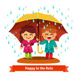 Boy and girl standing in the rain under umbrella Stock Photography