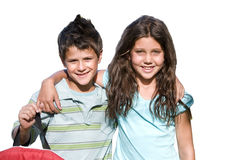 Boy and girl standing side by side, arms around each other, smiling, front view, portrait, cut out Stock Photography
