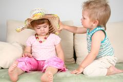 Boy and girl in straw hat with beads Royalty Free Stock Image