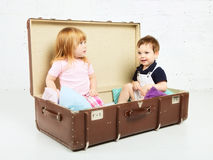 Boy and Girl in Suitcase Stock Images