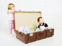 Boy and Girl in Suitcase Stock Photos