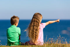 Boy and girl during summer time Royalty Free Stock Images