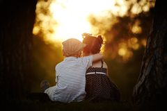 Boy and girl on sunset Royalty Free Stock Photo