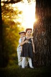 Boy and girl on sunset Royalty Free Stock Photography