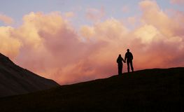 Boy and girl on sunset background stock photography