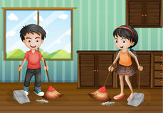 Boy and girl sweeping the floor Stock Images