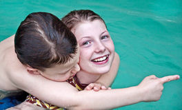 Boy and Girl Swimming in Pool Closeup Royalty Free Stock Image