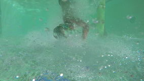 Boy and girl swimming under water stock video