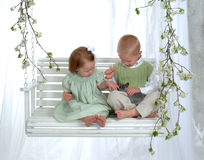 Boy and Girl on Swing with Bunny Royalty Free Stock Photos