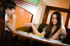 Boy and girl at table together Royalty Free Stock Photos