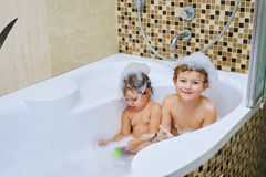 Boy and girl take water treatments in the bathroom Royalty Free Stock Photo