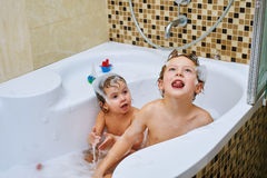 Boy and girl take water treatments in the bathroom Royalty Free Stock Image