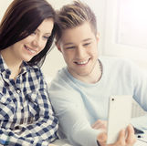 Boy and girl taking selfie on a lesson at school Stock Image