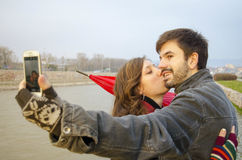 Boy and girl taking a selfie outdoors Stock Image