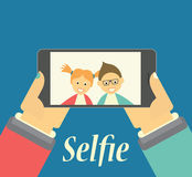Boy and Girl taking selfie picture on their phone Stock Photos