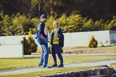 Boy and girl talking before workout. Young boy and girl before training talking in the stadium, preparing for workout Royalty Free Stock Photography