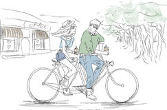 The boy and the girl on a tandem bike. Boy and girl hipsters coffee on a tandem bike. Advertisement coffee Stock Images