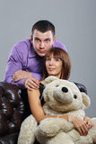 Boy, girl and teddy bear Stock Photography