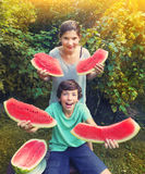 Boy and girl teen have fun eating water melon Royalty Free Stock Photo