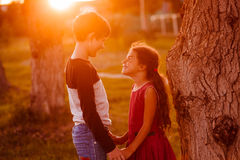 Boy girl teens are holding hands romance. Friendship love at sunset in summer stock images
