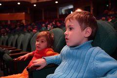 Boy and girl in theater Stock Photo