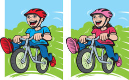Boy and girl on their bikes Royalty Free Stock Photos
