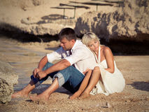 Boy and girl think on beach Stock Photos