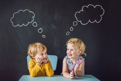 The boy and the girl are thinking, choosing.  royalty free stock image