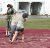 Boy and Girl Throwing Holi Powder Stock Photo
