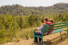 Boy and girl sitting together Stock Images