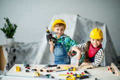 Boy and girl with tools Royalty Free Stock Photos