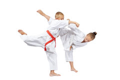 Boy and girl are trained karate blows Stock Image