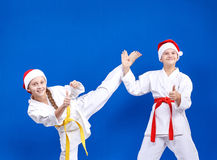 Boy and girl are training kick leg and show finger super Stock Photography